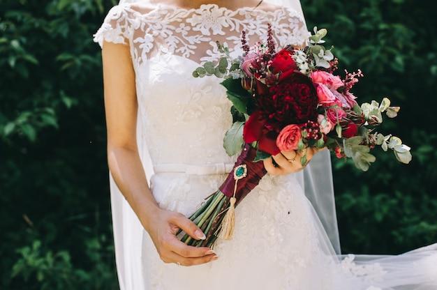 Wedding dress, wedding rings, wedding bouquet Premium Photo