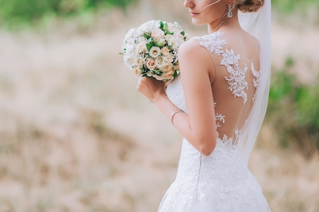 Wedding dress, wedding rings, wedding bouquet Premium Photo