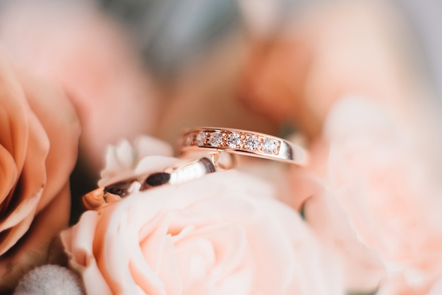 Premium Photo | Wedding engagement rings and flowers wedding bouquet  background, selective focus, macro