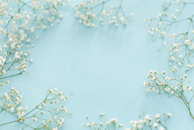 Wedding Flower Frame On Blue Background From Above Beautiful Floral Pattern Flat Lay Style Premium Photo