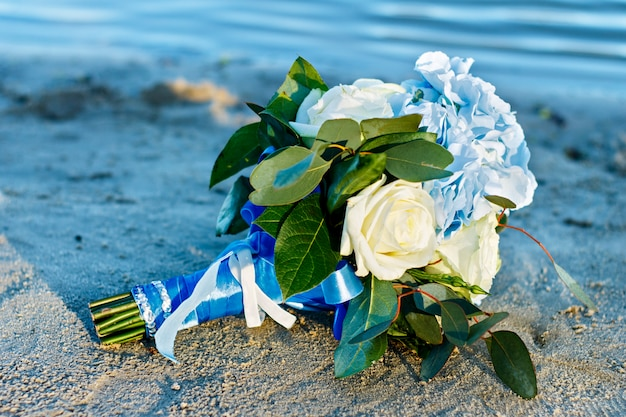 Wedding flowers in summer. exit wedding ceremony by the water. Premium Photo