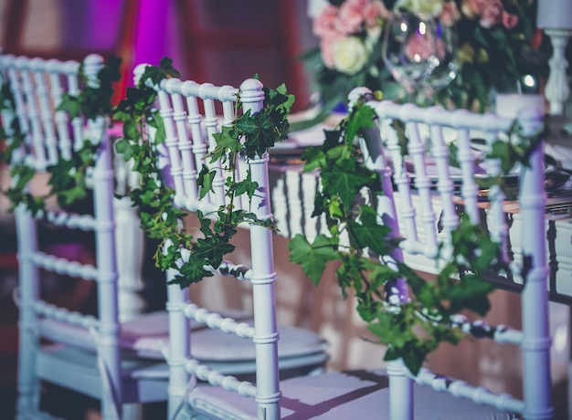 Wedding hall furniture decorated with flowers and leaves Free Photo