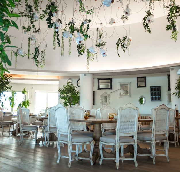 Wedding hall with white wooden furniture interior Free Photo