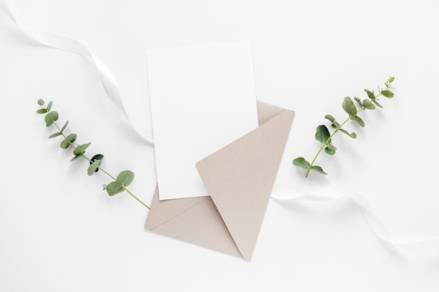 Wedding invitation and branches Free Photo