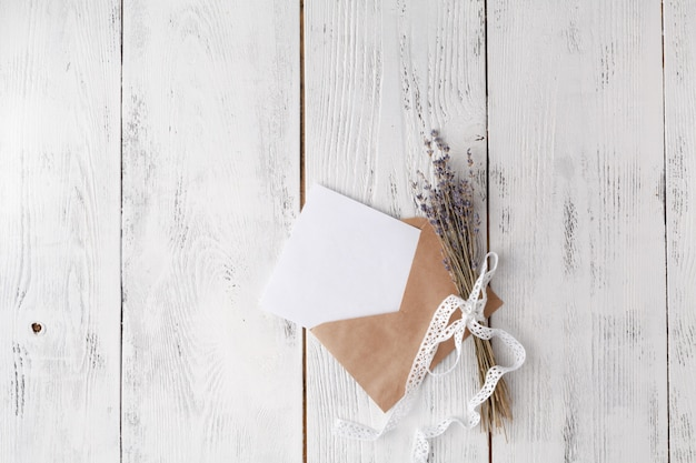 Wedding invitation card with envelope on wooden table Premium Photo