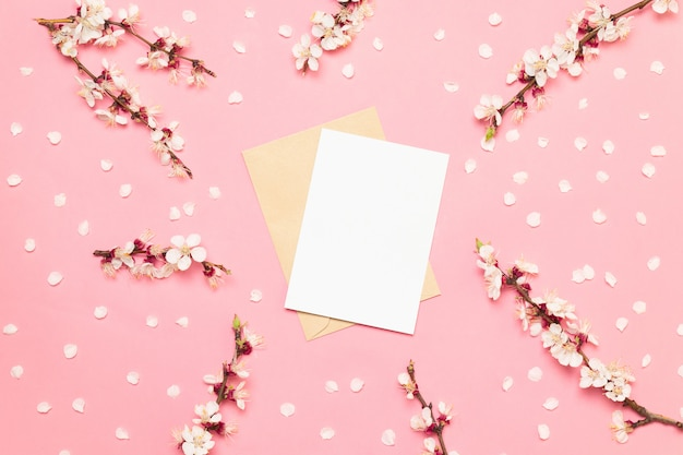 Wedding invitation cards with pink flowers on a pink background Premium Photo
