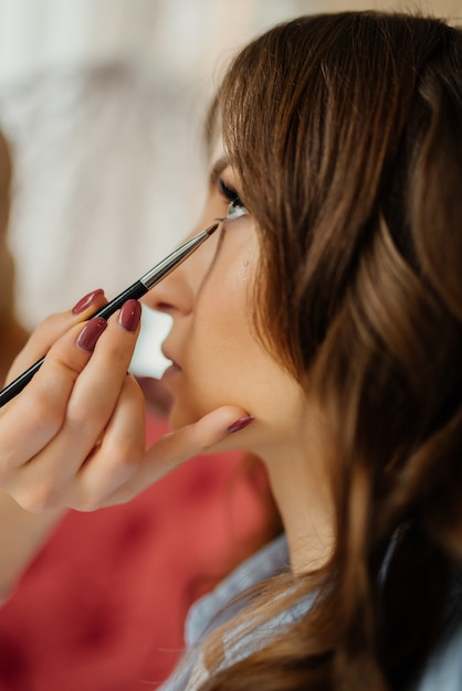 Premium Photo Wedding Makeup Artist Making A Make Up For Bride Beautiful Model Girl Indoors Female Portrait Bridal Morning Of A Cute Lady Wedding Preparation Concept