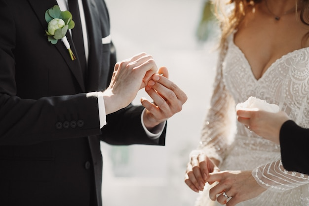 The wedding moment with the putting rings on the fingers Free Photo