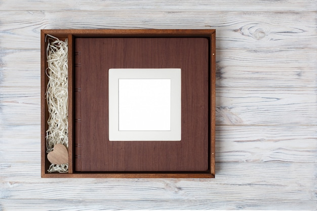 Wedding photo book with wooden box. Premium Photo
