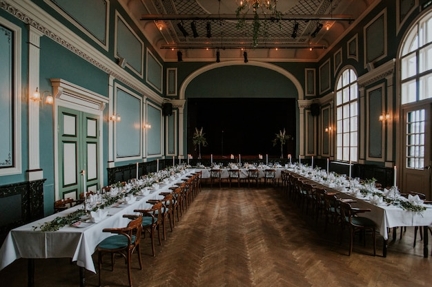 Wedding reception hall with an elegant table setting with candles Free Photo