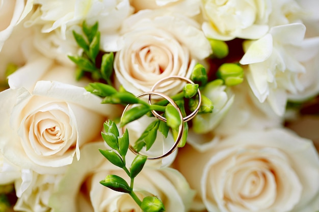 Wedding rings close-up on bouquet. wedding decor Premium Photo