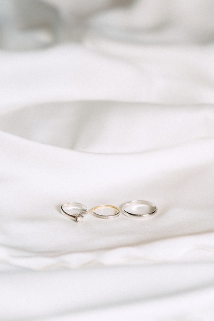 Wedding rings high angle view on a cloth on white background Free Photo
