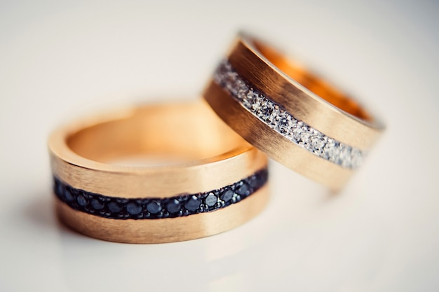 Wedding rings. jewelry white and yellow gold. wedding ring on a white Premium Photo