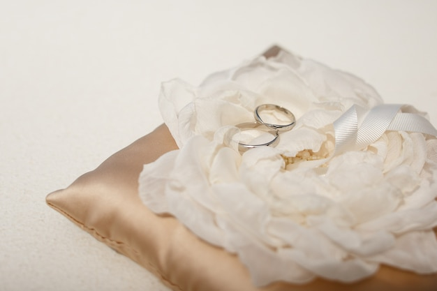 Wedding Rings Made Of White Gold Lie On The Cloth Flower Photo