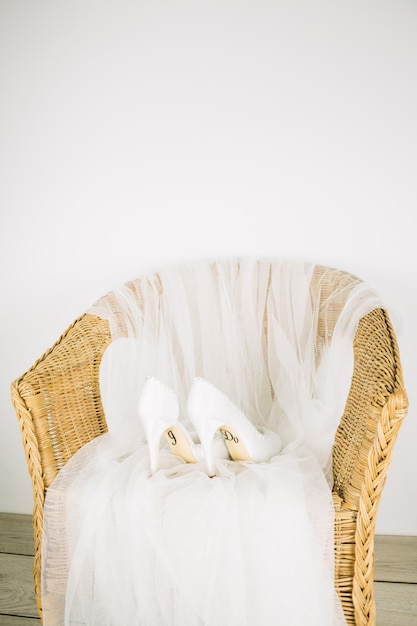 Wedding shoes in an armchair Free Photo