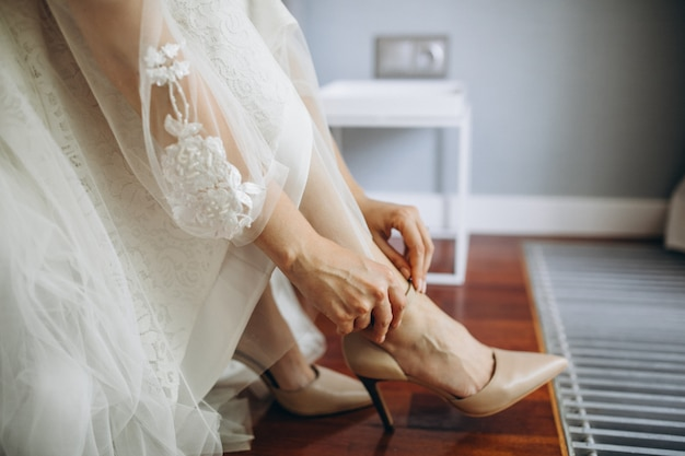 Wedding shoes on a bride on her wedding day Free Photo