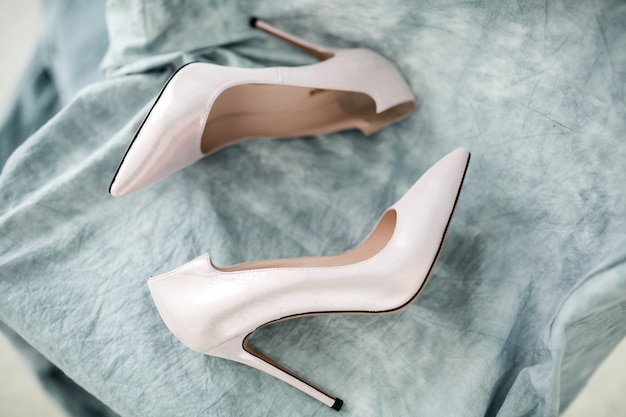Wedding shoes and rings Free Photo