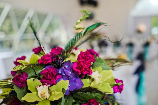 Wedding table decorated with flowers, dinner at the restaurant, banquet Premium Photo