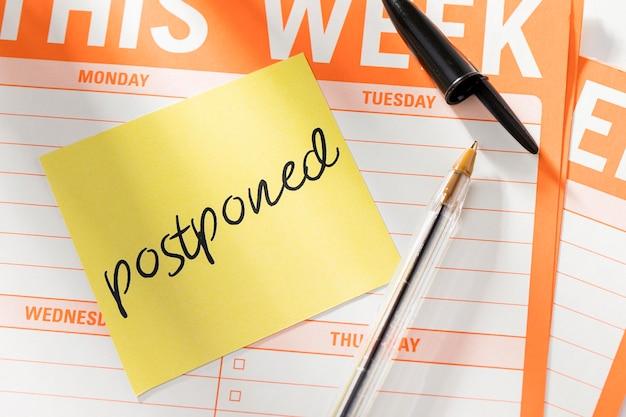 Week agenda with postponed message Free Photo