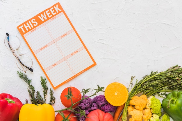 Weekly meal plan with colorful fruits and vegetables on ...