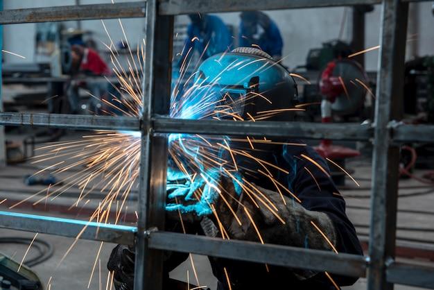 Welder in factory Premium Photo