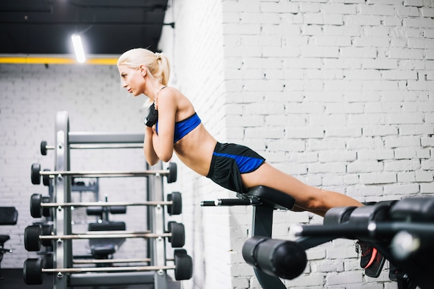 Well-built woman doing back extensions Free Photo