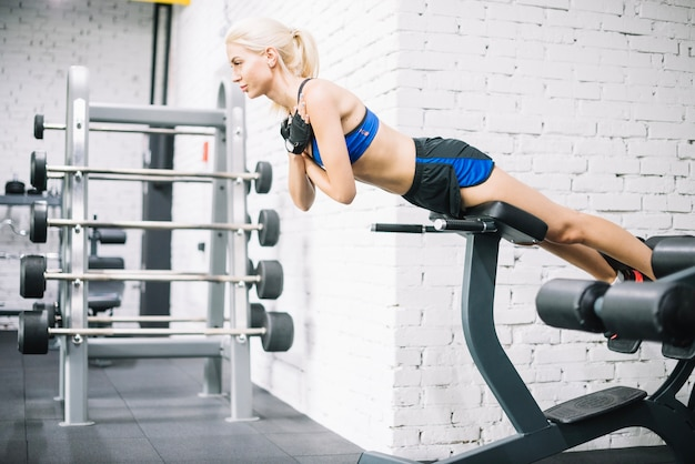 Well-built woman doing exercises for back Free Photo