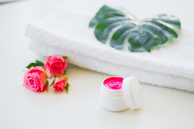 Wellness products and cosmetics. herbal and mineral skincare. jar of cream, white cosmetic bottles. without label. spa set with soap and white towel Premium Photo