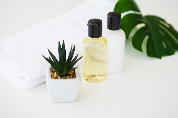 Wellness products and cosmetics. spa still life with blossoms of rose and essential oils Premium Photo