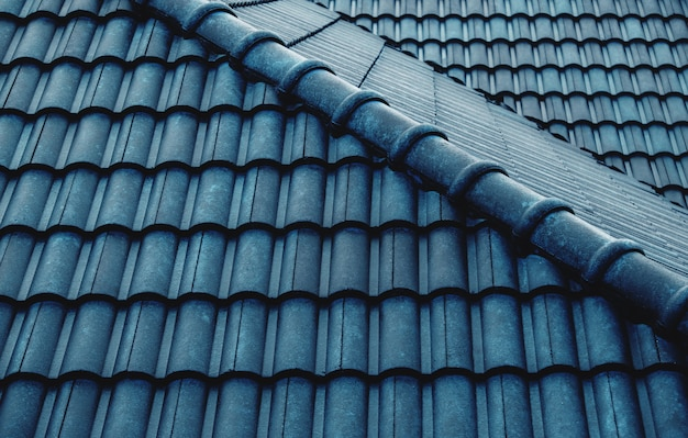 Wet blue tiles roof Premium Photo