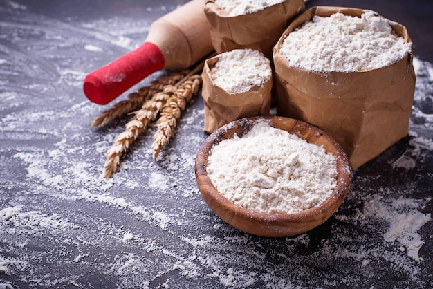 Wheat flour, ears and rolling pin Premium Photo