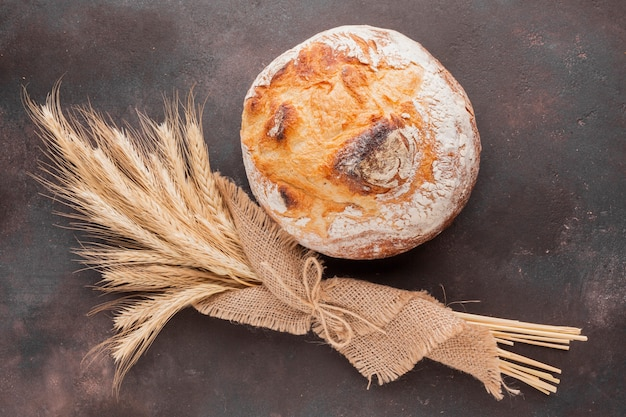 Wheat grass in jute cloth and bread Free Photo