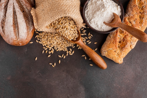 Wheat seeds bag and bowl of flour Free Photo