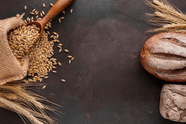 Wheat seeds and bread flat lay Premium Photo