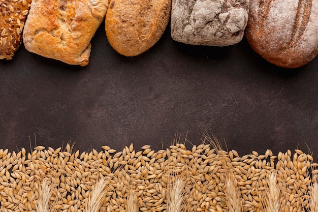 Wheat seeds and bread frame Free Photo