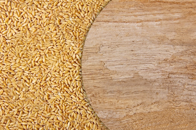 Wheat on wooden texture background Premium Photo