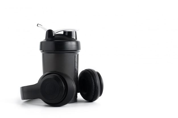 Whey protein shaker bottle with headphone isolated on white background Premium Photo