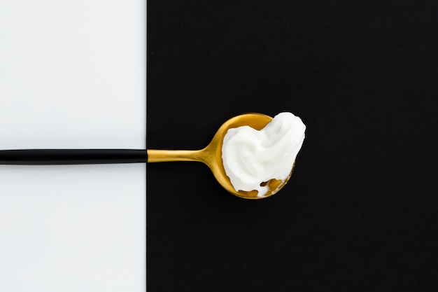 Whipped cream on  golden spoon Free Photo