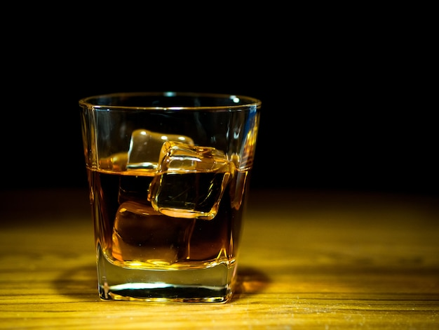 Whiskey in the glass pout on the table bar Premium Photo