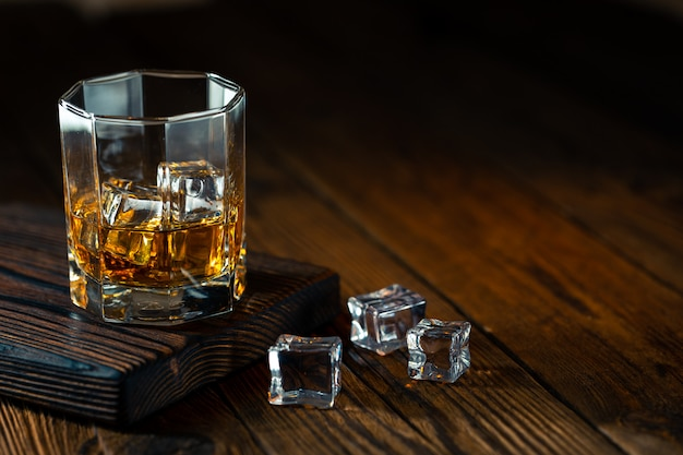 Whiskey in glass with ice Premium Photo