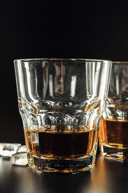 Whiskey and ice on rustic wood Premium Photo