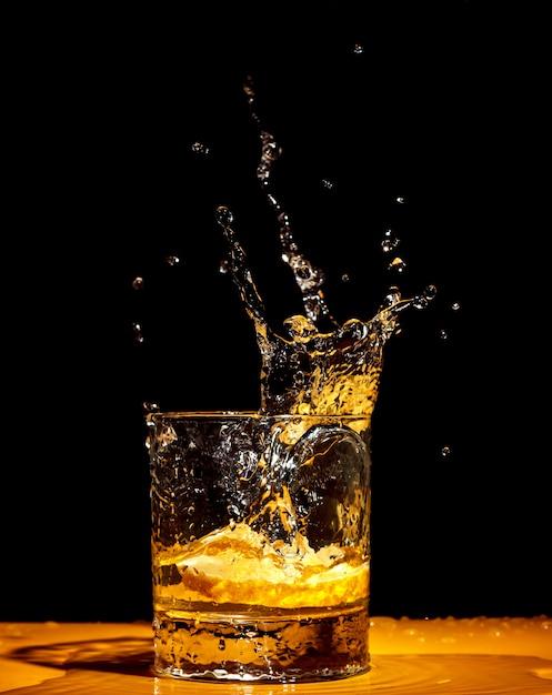 Whiskey splash from the glass Premium Photo
