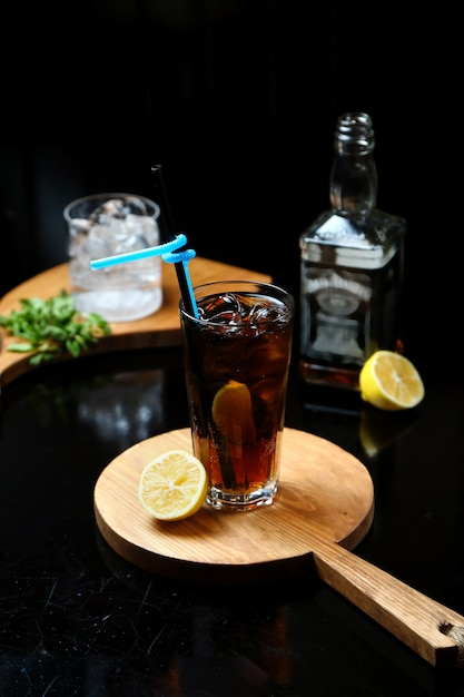 Whiskey with cola on wooden board Free Photo