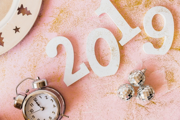 White 2019 inscription with clock and baubles Free Photo