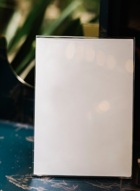 White a4 placard mockup inside of an acrylic stand Free Photo