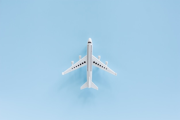 White airplane model on blue for vehicle and transportation concept Premium Photo