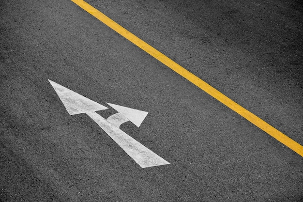 White arrow painted on asphalt road (go straight and turn right) Premium Photo