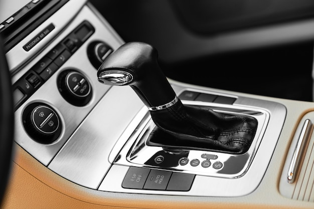 White automatic gear stick of a modern car, car interior details Premium Photo