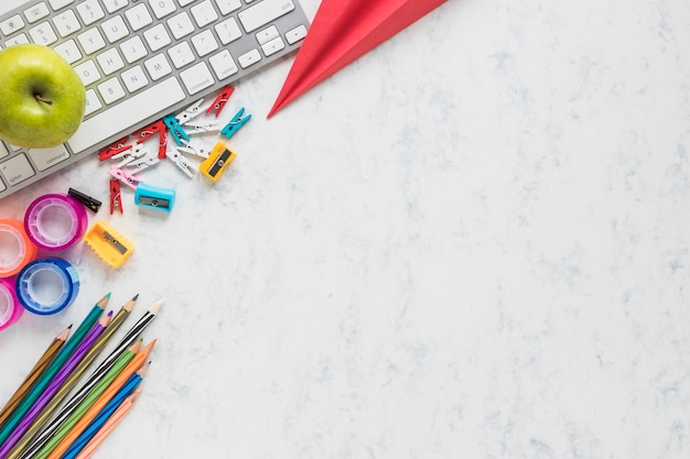 White background with school supplies in corner Free Photo