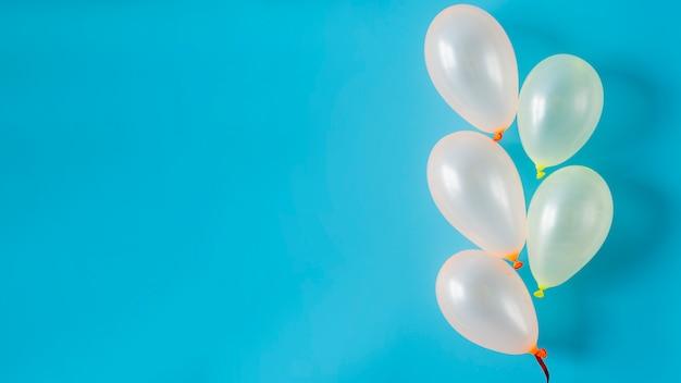 White balloons on blue background Free Photo